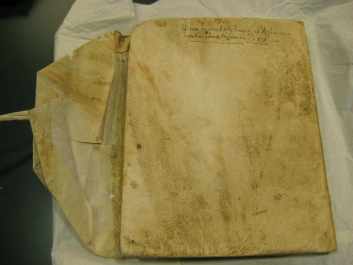 The cover says that the ledger begins in January 1752. It is bound in a brittle leather.
