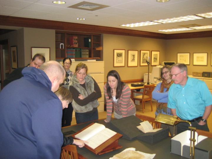 Teachers on the Library tour were intrigued by objects pulled from the F. Ambrose Clark Rare Book Room...