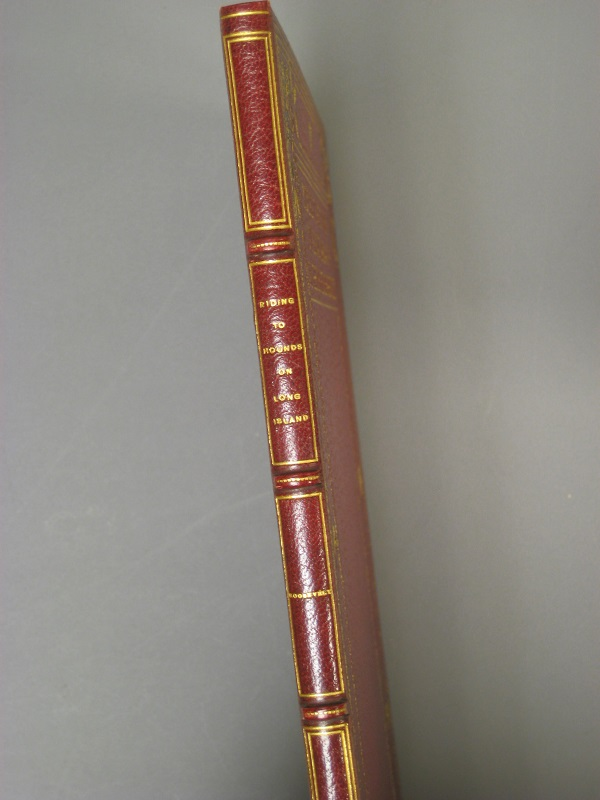 Red leather and gilt decorations grace this custom binding.