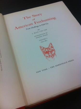 "Title page of ""The Story of American Foxhunting."" I love the red fox mask"