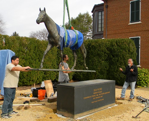 Sculpture expert Benjamin Gage and his team lower Sea Hero into place at NSLM.